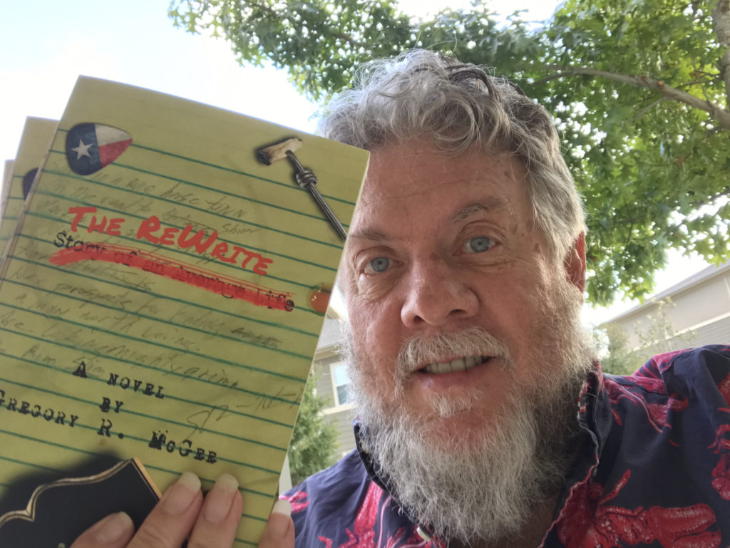 "Me holding copies of my book ""The Rewrite"""